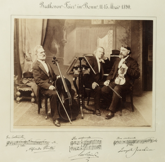 Portrait of Alfredo Piatti, Carl Reinecke and Joseph Joachim with musical quotations.  Beethoven Feier in Bonn, 11-15 Mai 1890.  Sepia photograph.