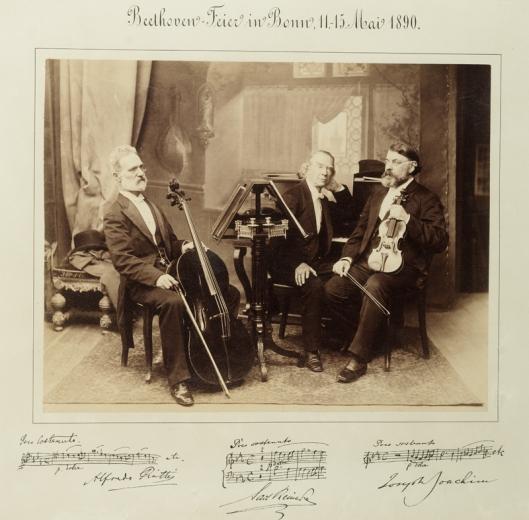 Portrait of Alfredo Piatti, Carl Reinecke and Joseph Joachim with musical quotations.  Beethoven Feier in Bonn, 11-15 Mai 1890.  Sepia photograph.